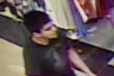 This video image provided by Skagit County Department of Emergency Management shows a suspect wanted by the authorities in connection with a shooting at the Cascade Mall in Burlington, Wash.